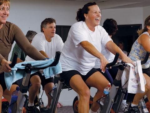 Group of women on exercise bikse